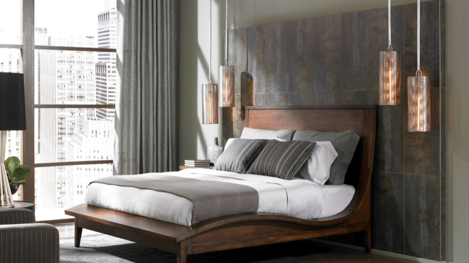 Metallic pendant lights complements wooden accents in the Contemporary bedroom