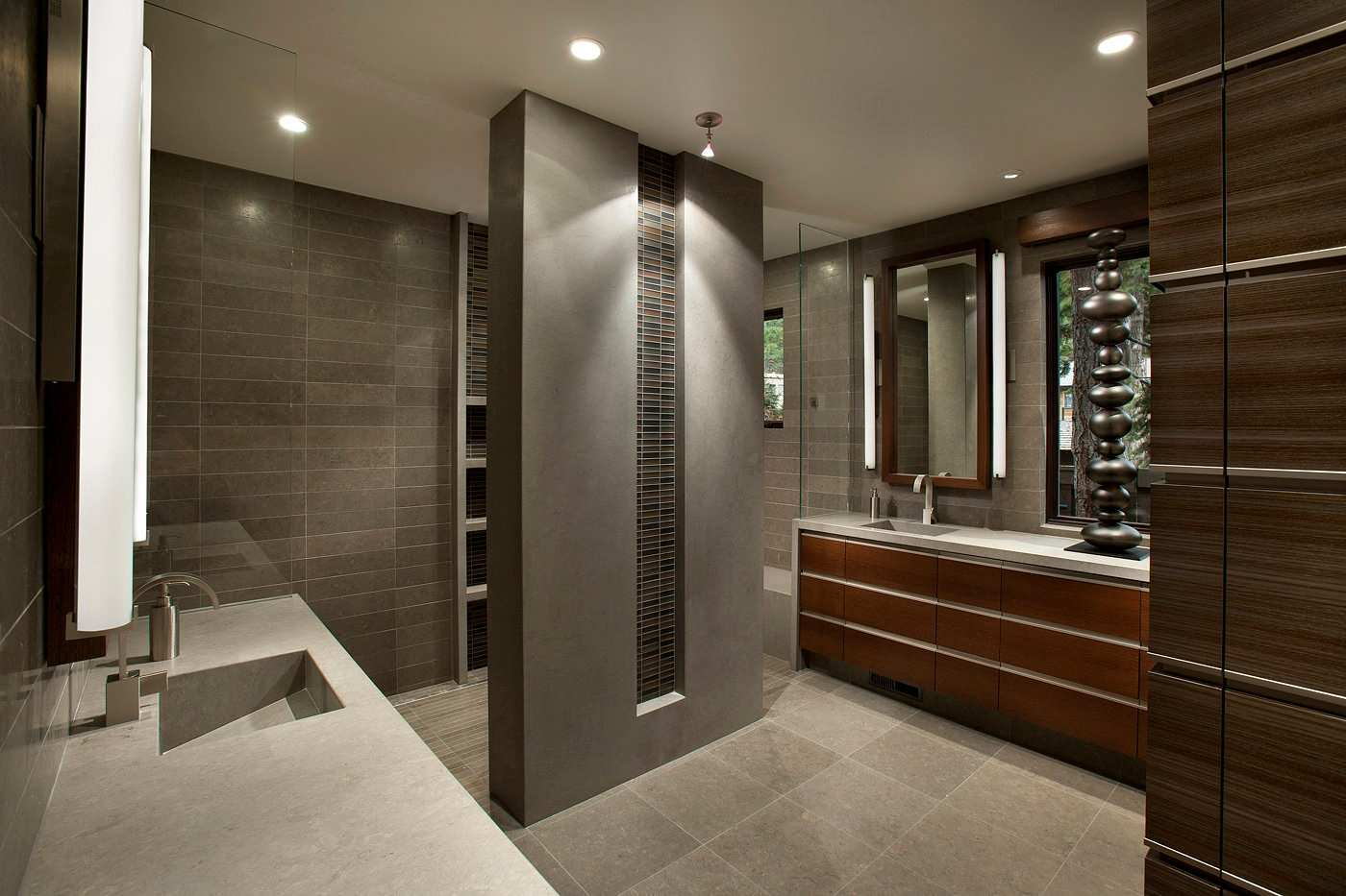 Elements of stone and wood in a Contemporary bathroom