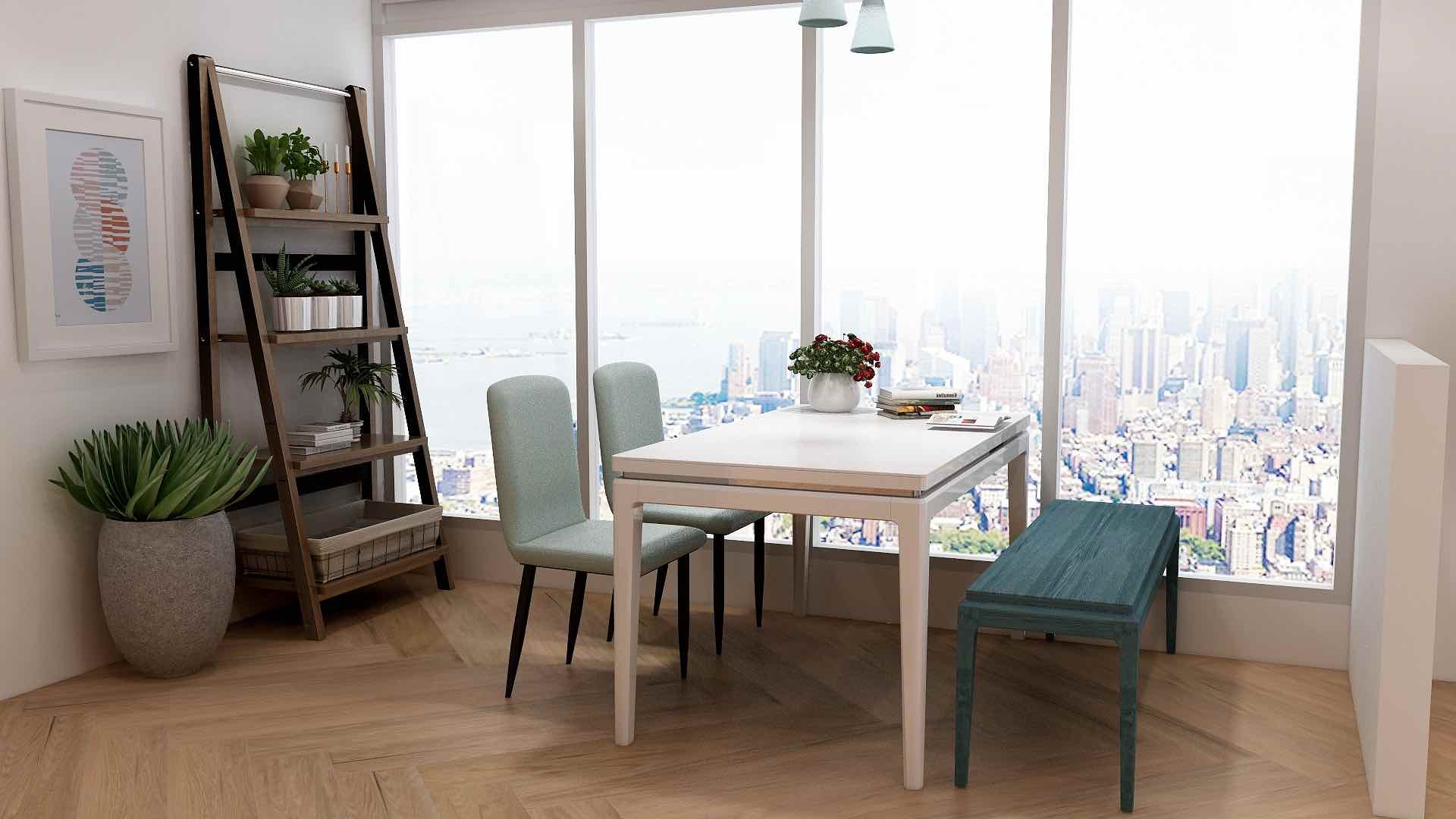 White dining table with blue chairs and plant decor beside a large window