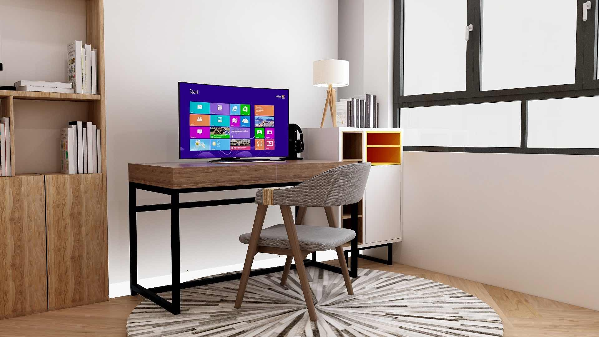 Computer screen on wooden study table with modern chair in a study room