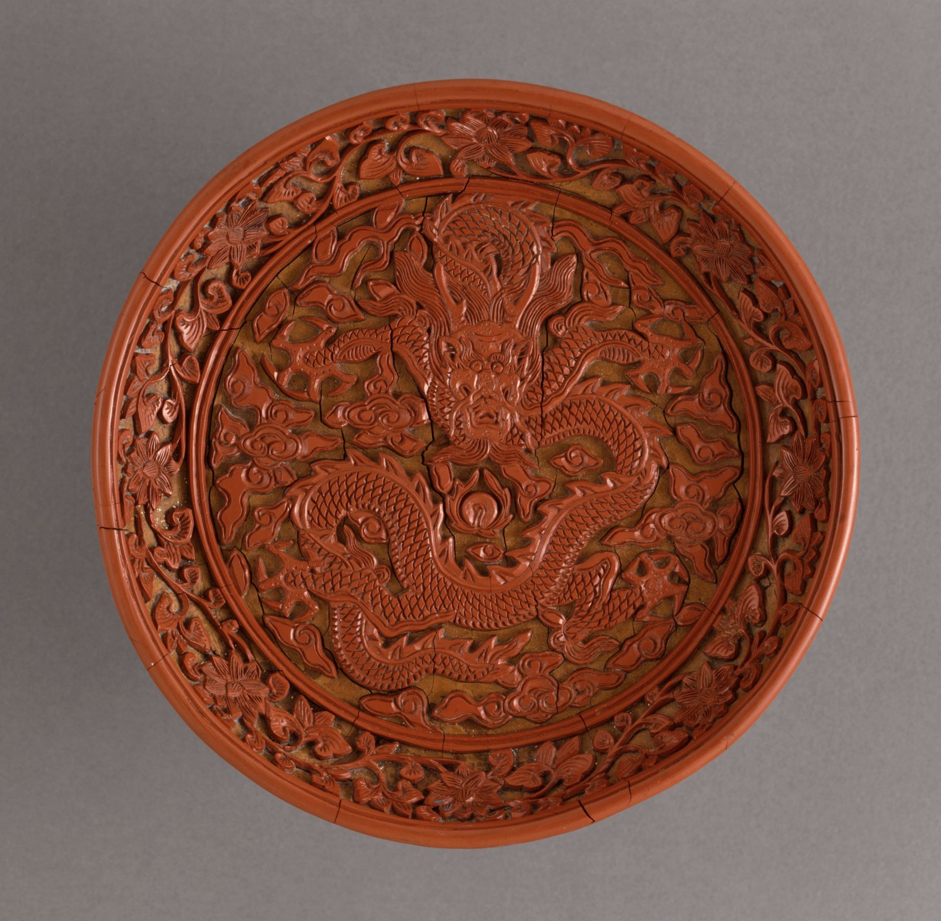 Lacquered ancient Chinese bowl with intricate dragon design