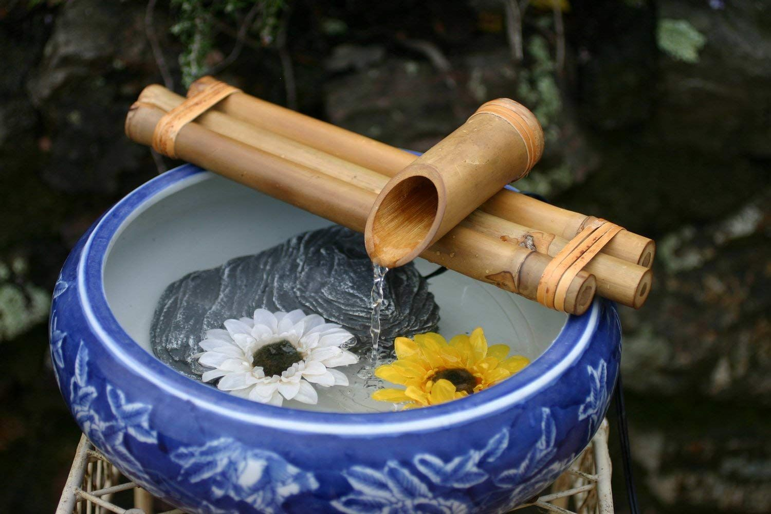 Small bamboo water fountain in a porcelain bowl