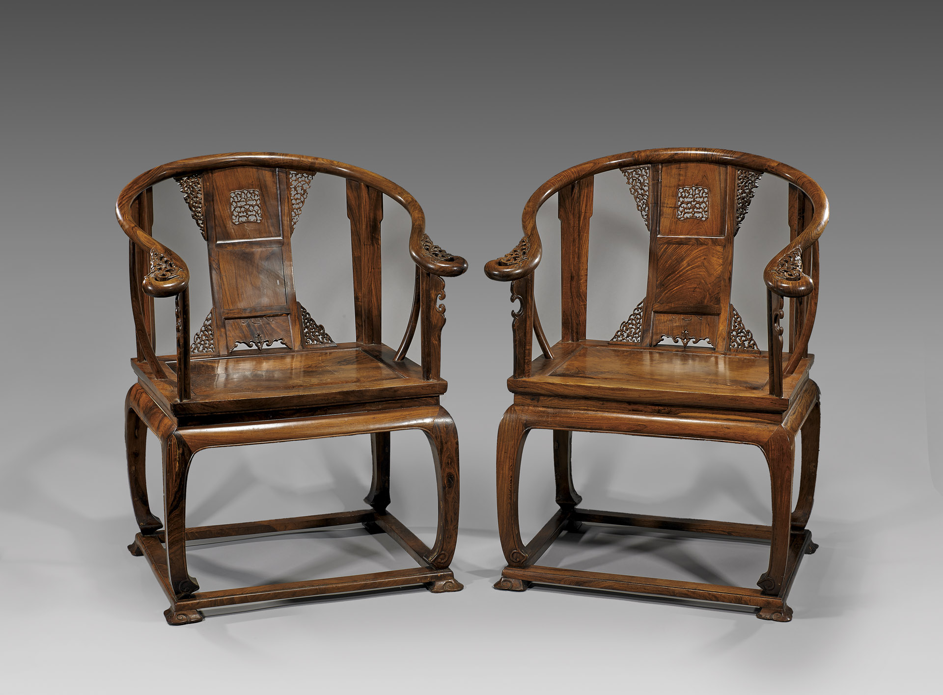 Two elaborately designed Ming Dynasty chairs side-by-side