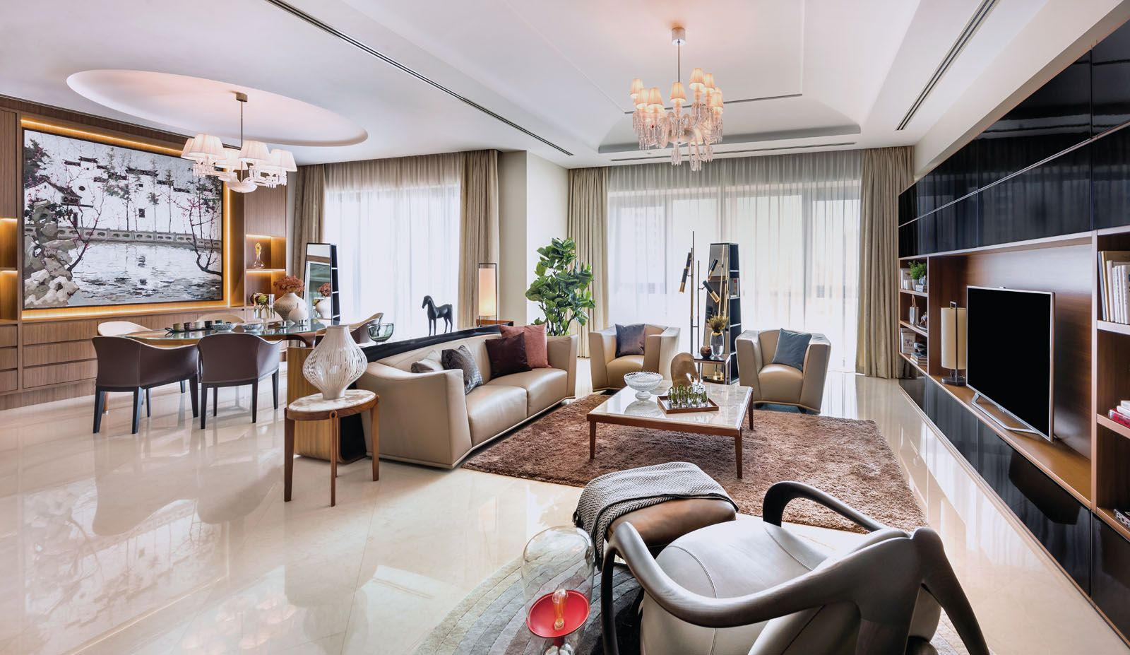 Open-concept home with modern furniture and large Oriental Chinese decor pieces with accent lighting