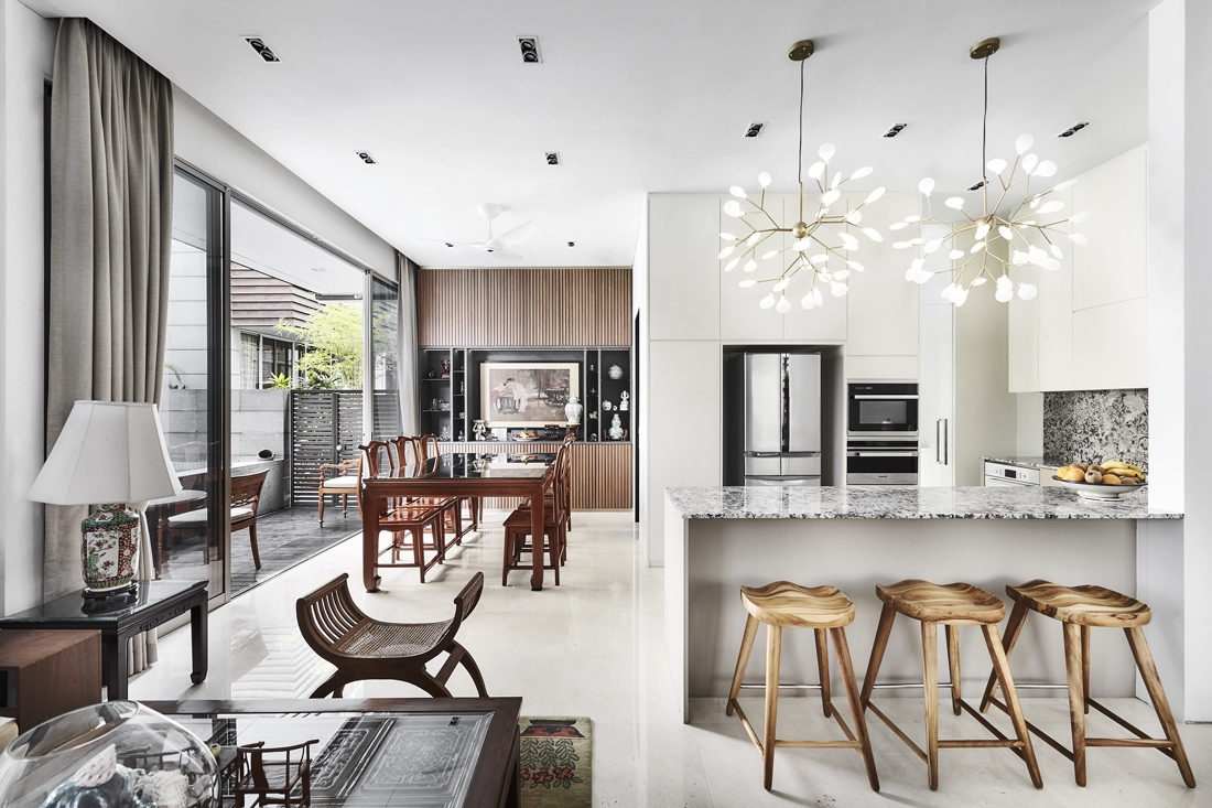 Open concept terrace home kitchen and dining area utilizing Oriental Chinese furniture and decor