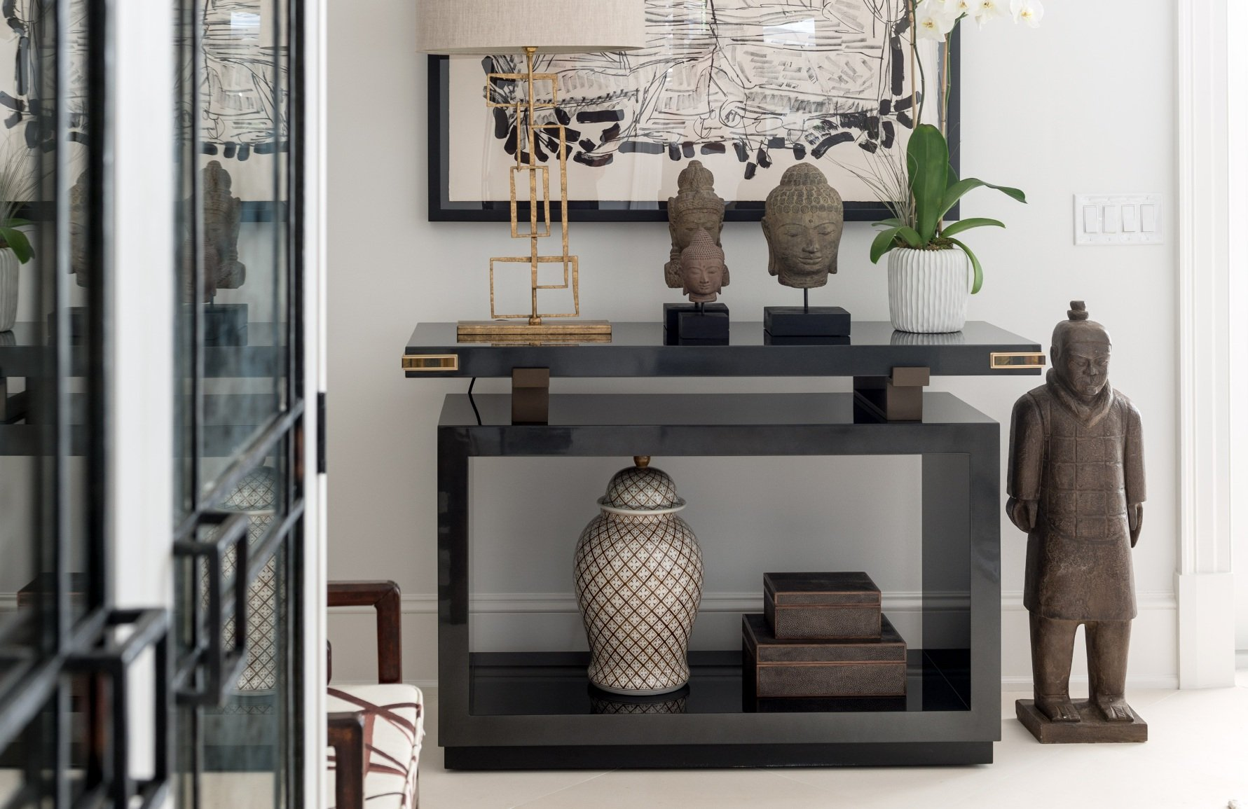 Chinese terracotta inspired decor and other accessories in a dedicated area of the home for displaying decor