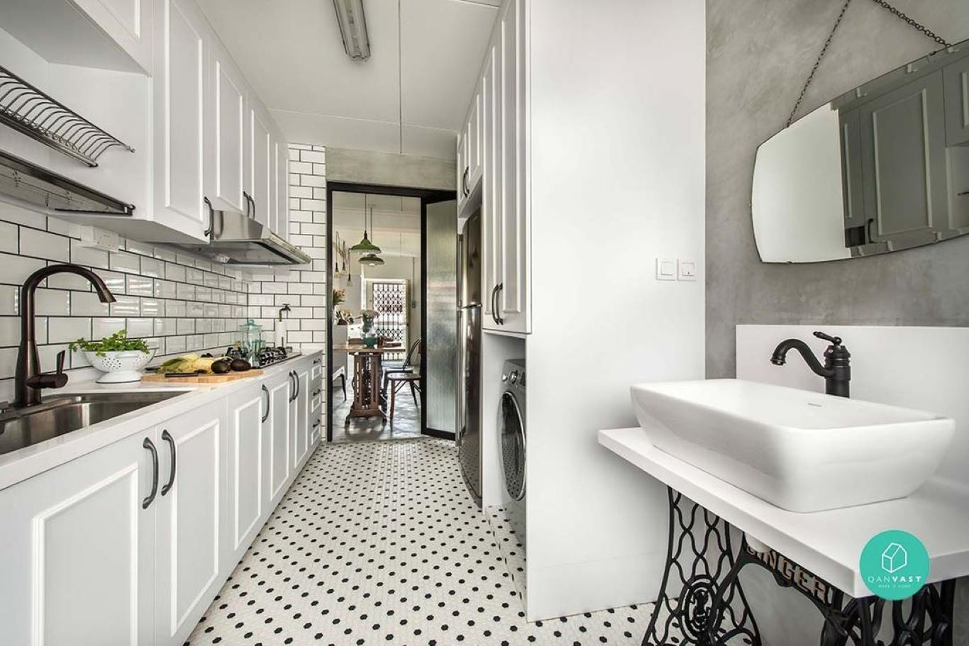 Modern fixtures complemented with 60s polka-dotted mosaic flooring in a galley kitchen