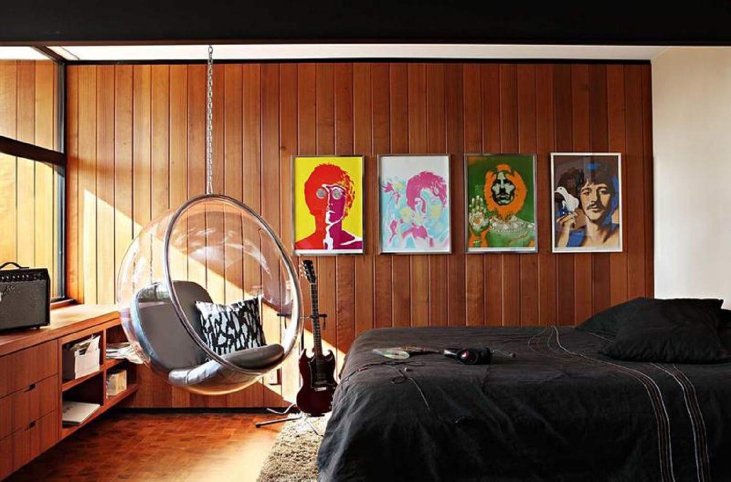 Pop art graphics and acrylic bubble chair adds a fun element to the modern Retro interior setting