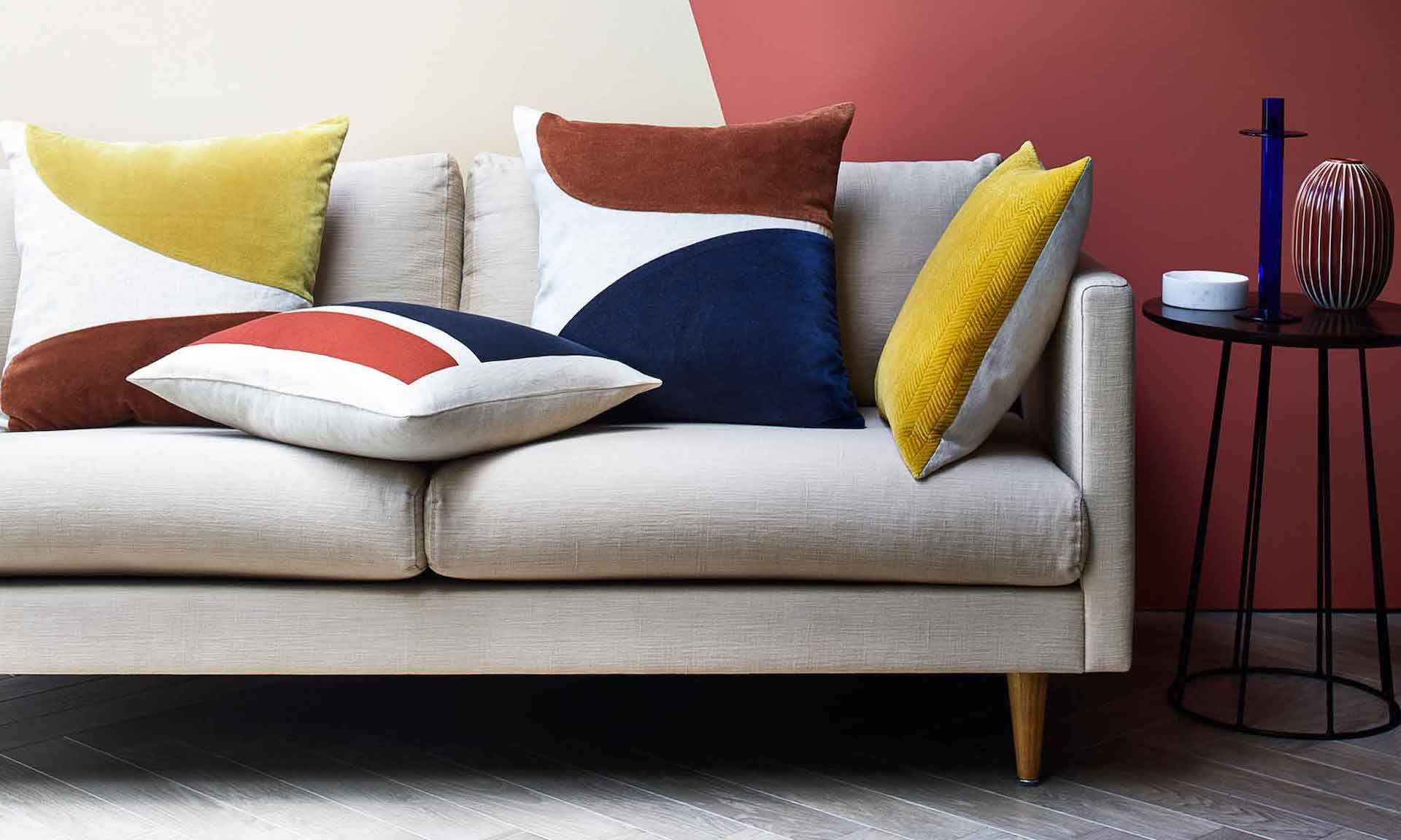 Colorful geometric patterns and velvet textures gives contrast on Retro furnitures.jpg