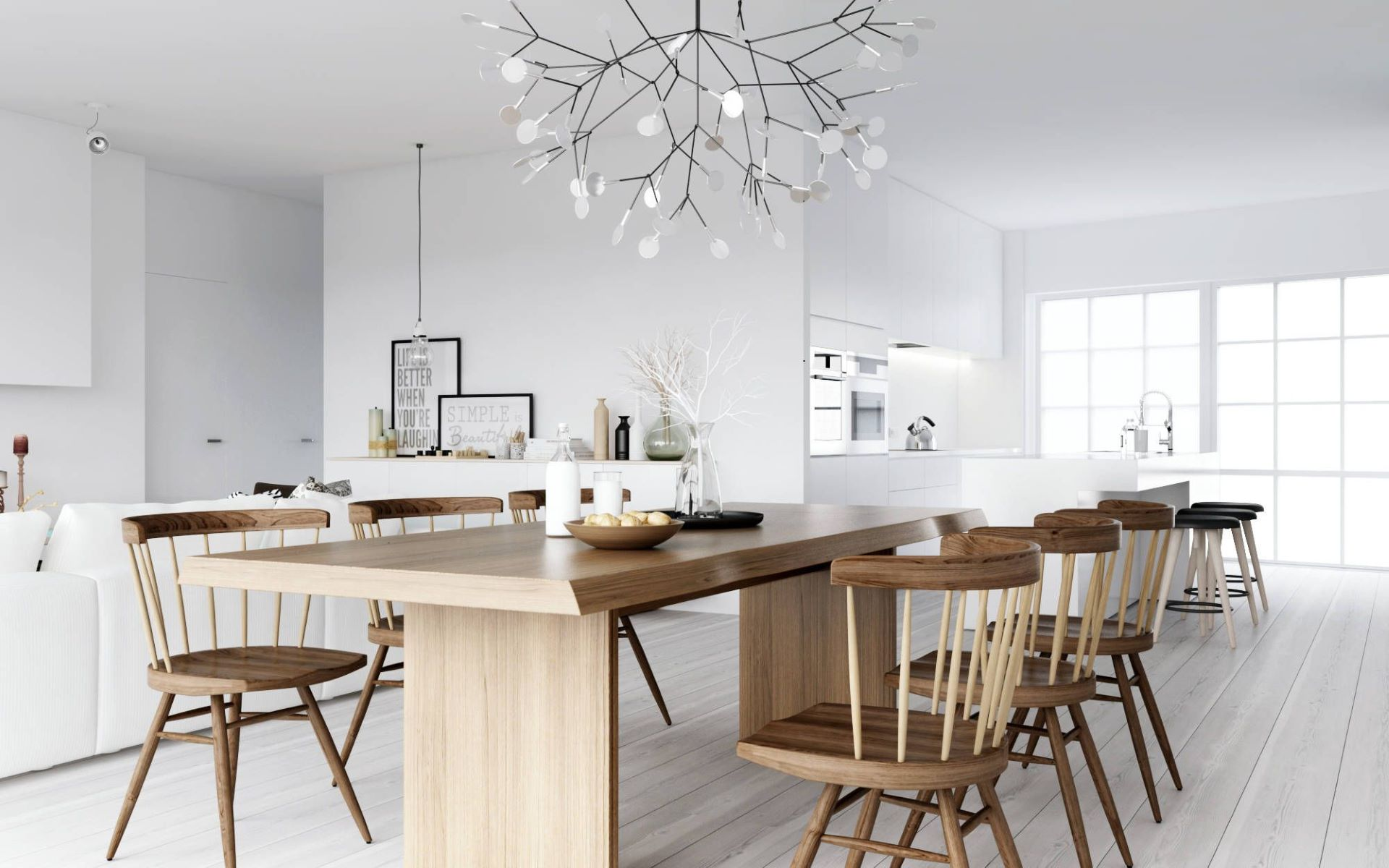 Nordic wooden dining table and chairs contrast with white walls and cabinetry