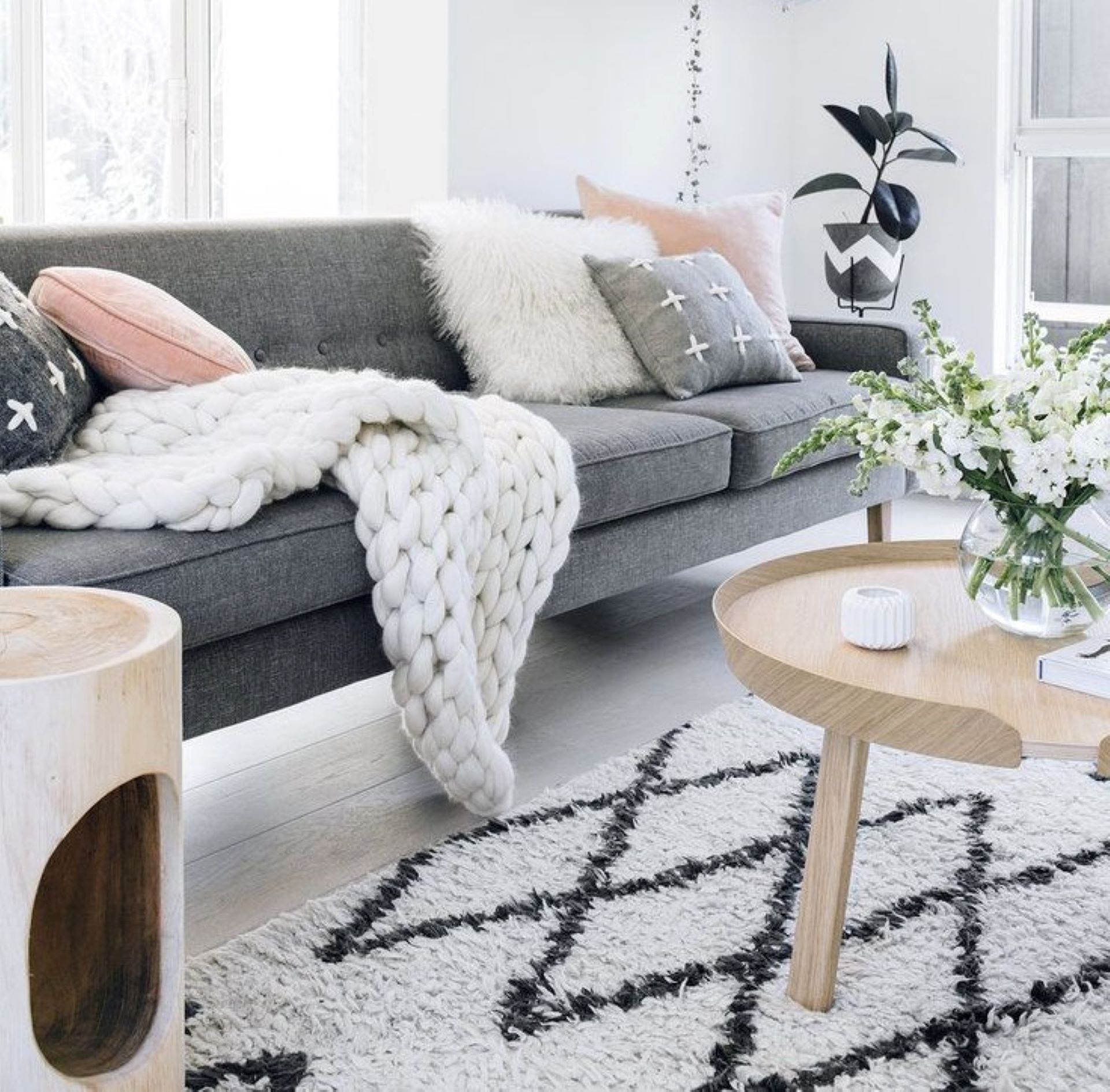 Sheepskin throw and Nordic coarse wool knitted blanket textures as Scandinavian decor