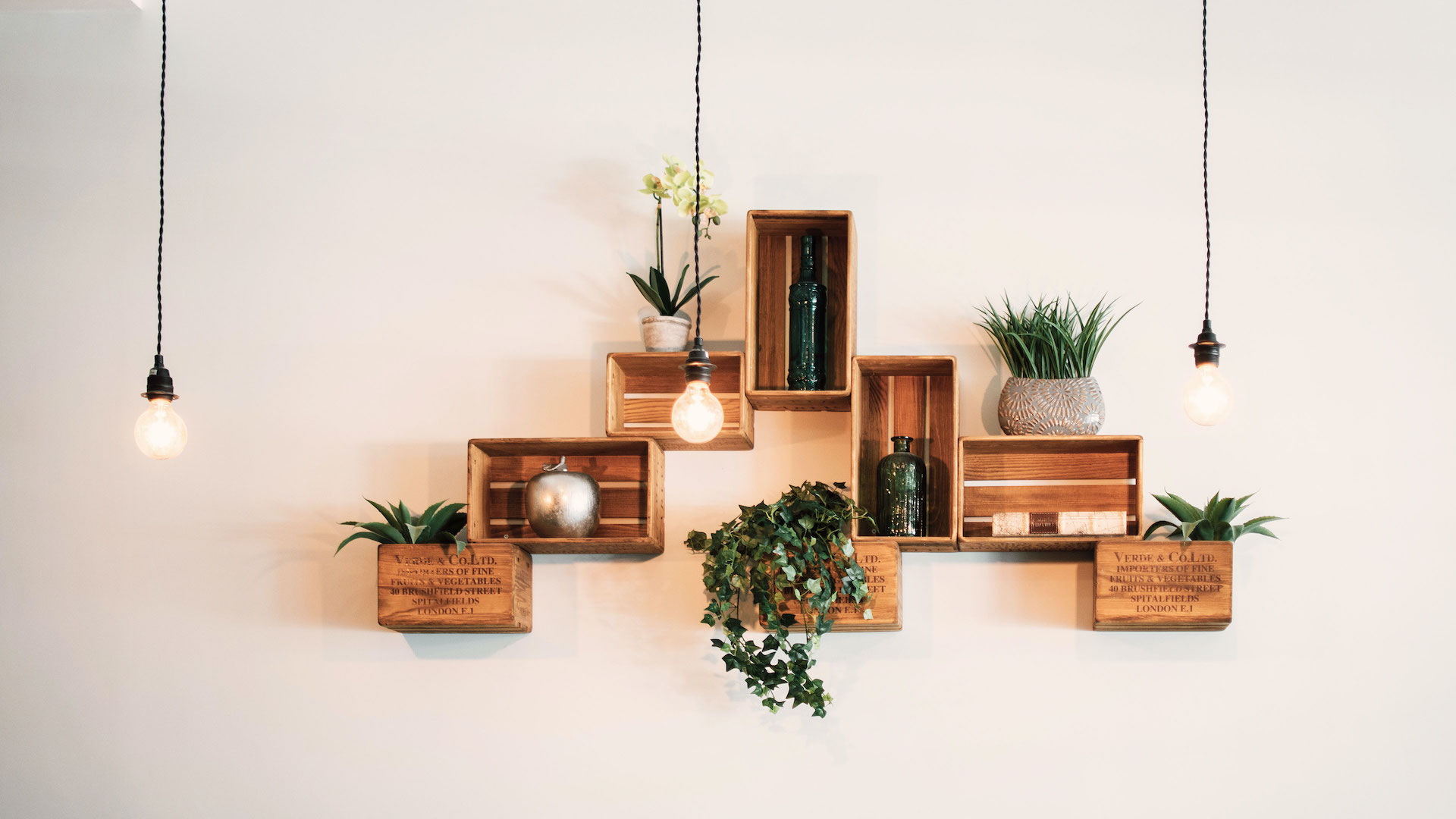 Reclaimed wood mailbox wall mount with plants and leaf stems works as Scandinavian decor