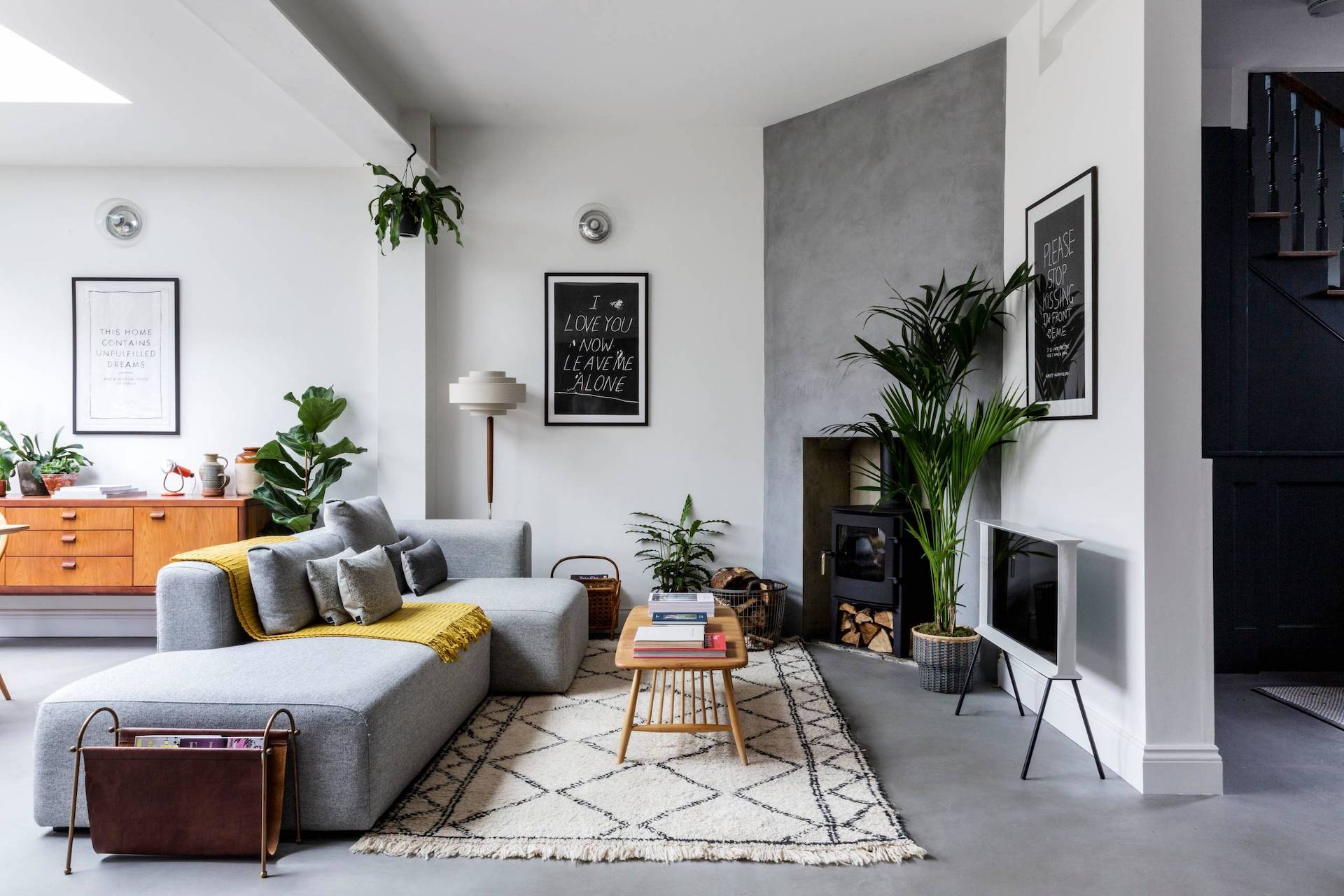 A well-balanced mix of modern wood and gray hue decor in a warm and inviting Scandinavian space