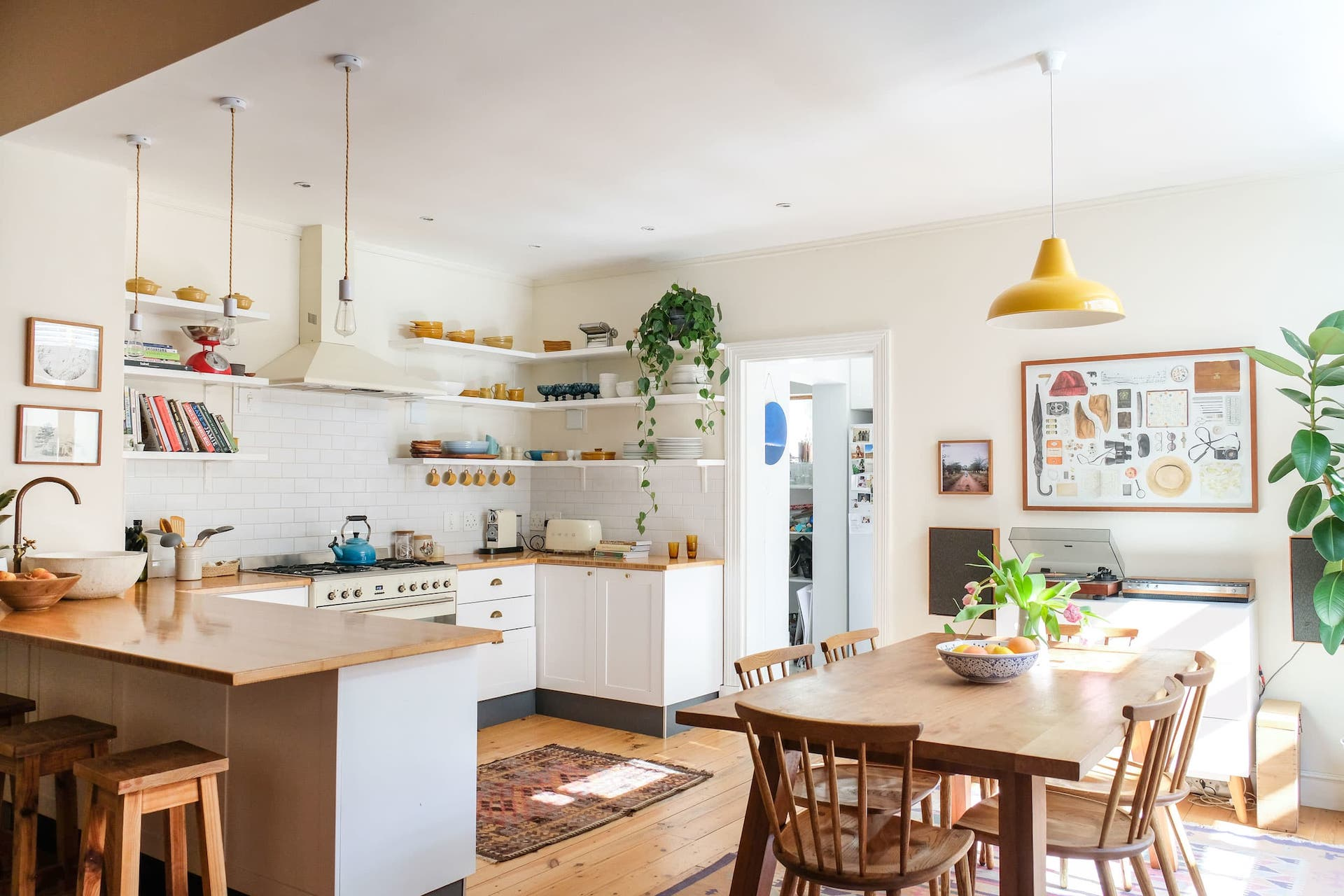 Scandinavian kitchen with warm wood cabinetry and pendant lights