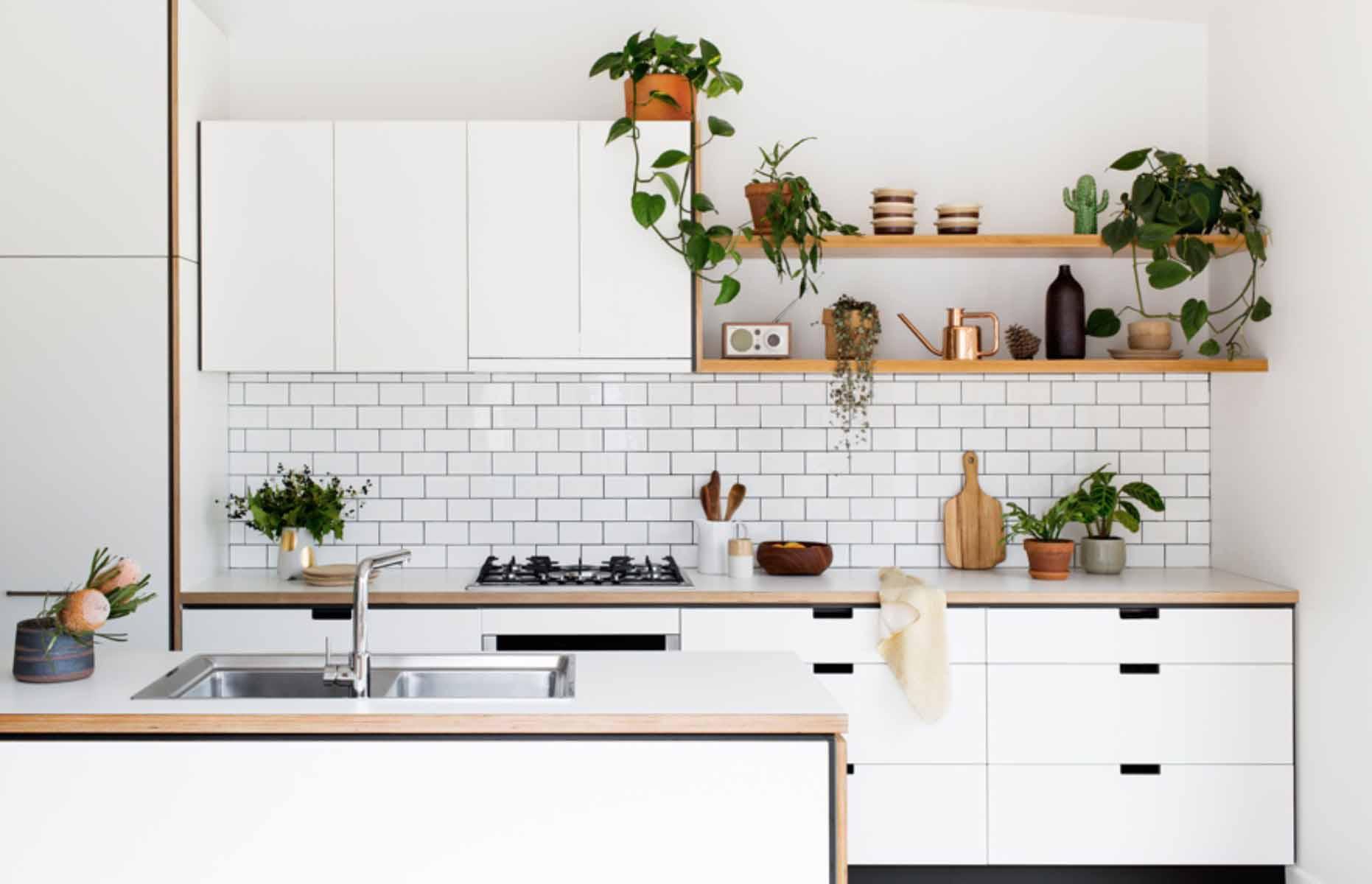 White gloss backsplash and wooden fixtures in a modern Scandinavian HDB kitchen