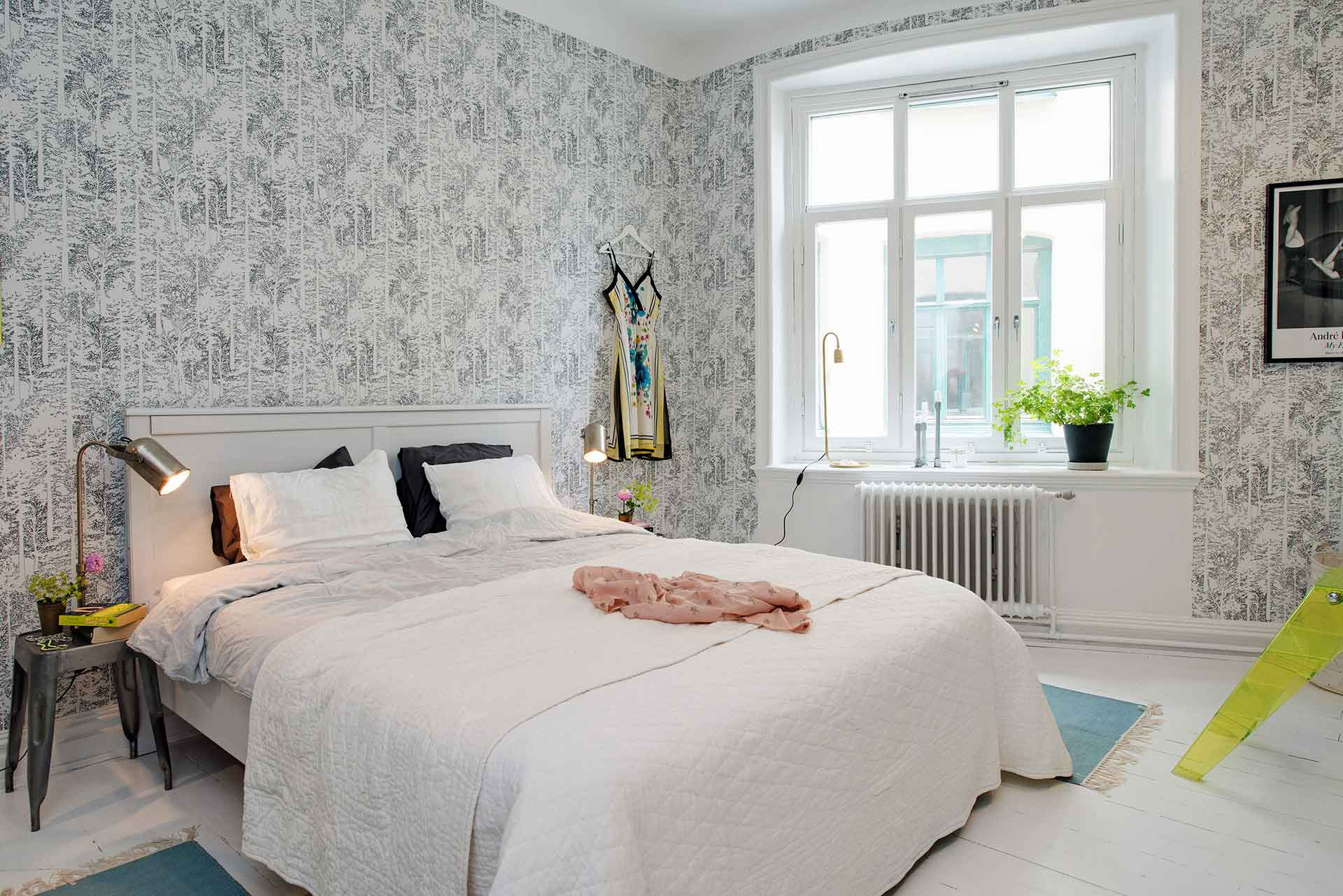 Decors are kept light and muted around the textured walls of a Scandinavian HDB master bedroom