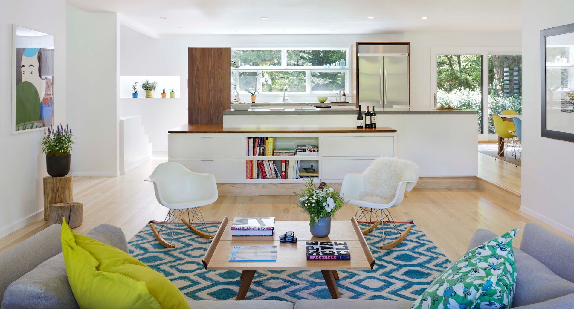 A modern Scandinavian style of wooden and white furniture accents in a living room of a terrace house