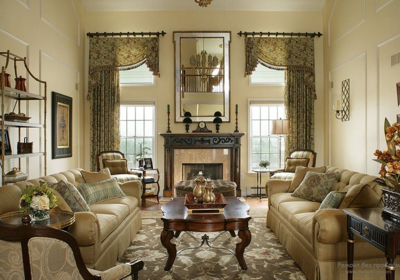 Carved wooden coffee table and patterned fabric sofas complement embellished window curtains.