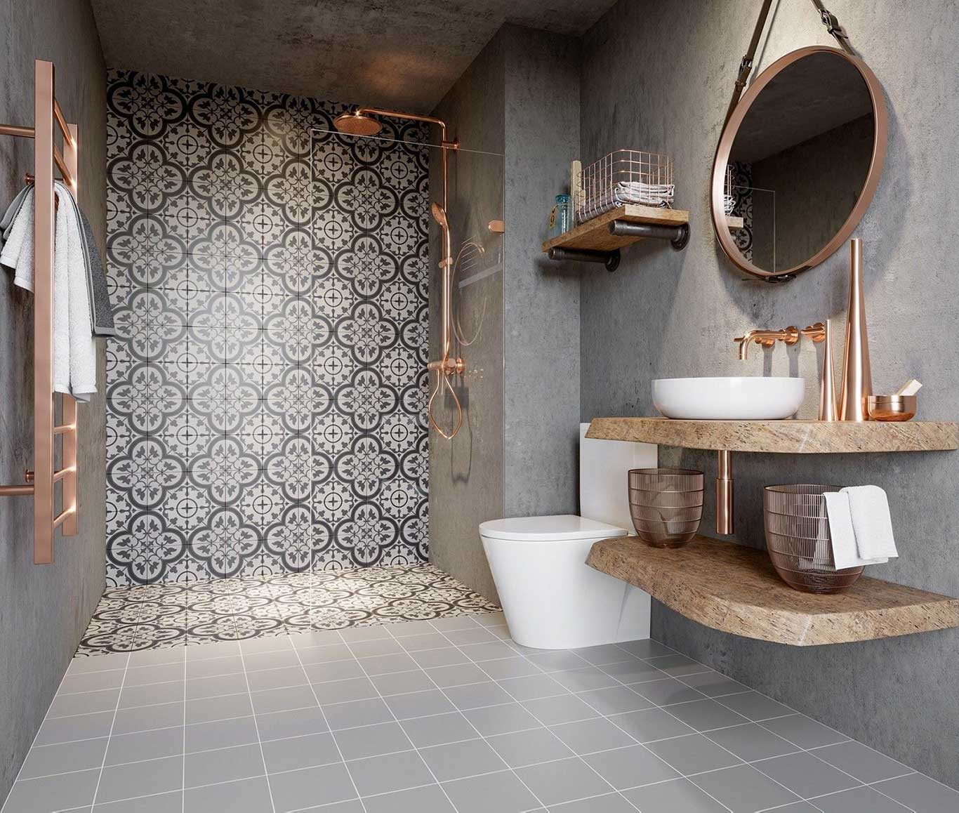 Modern Victorian grey-toned bathroom with  patterned tiles at the shower area and metallic copper finishes.