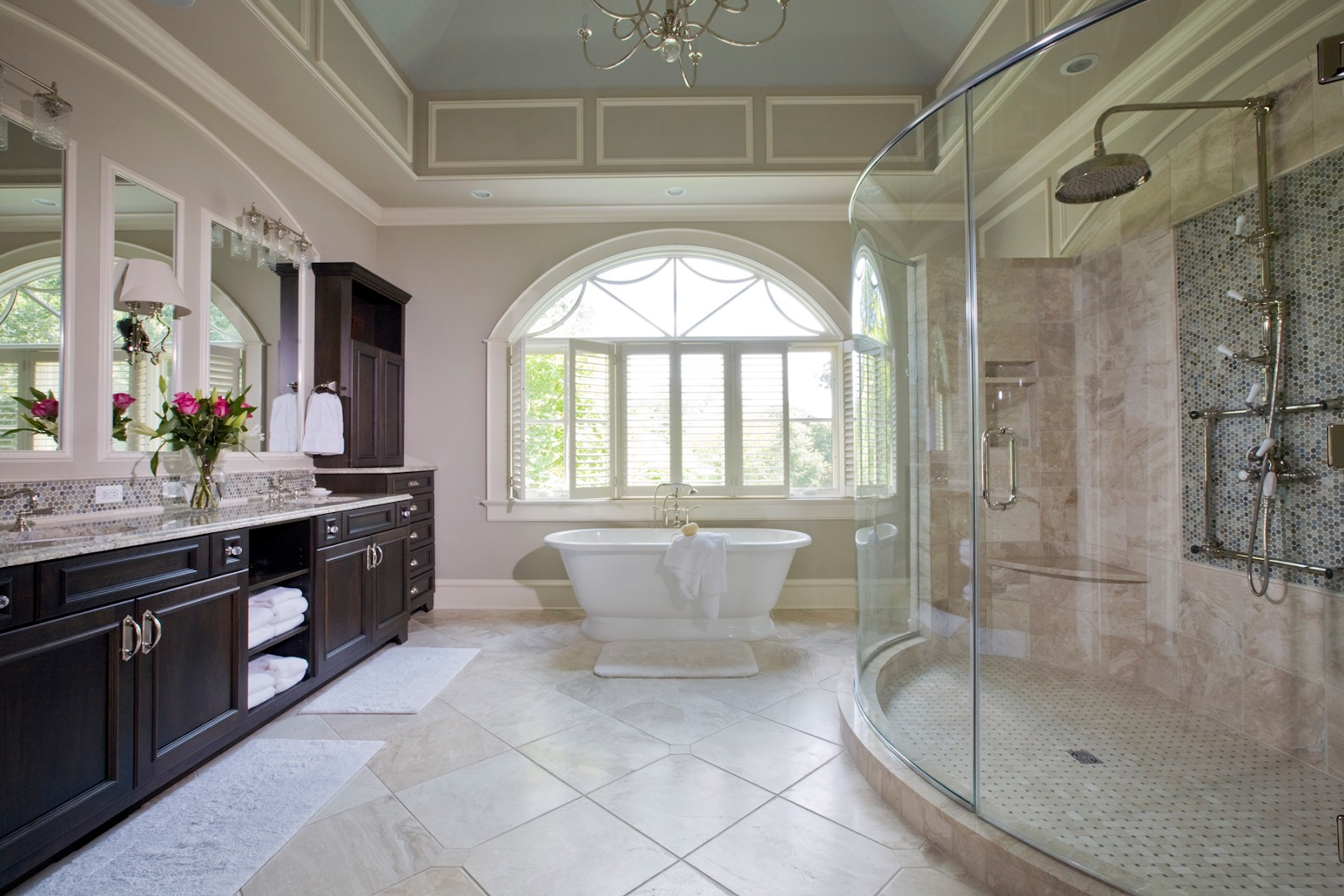 Large bathroom with stand-alone bathtub in the center.
