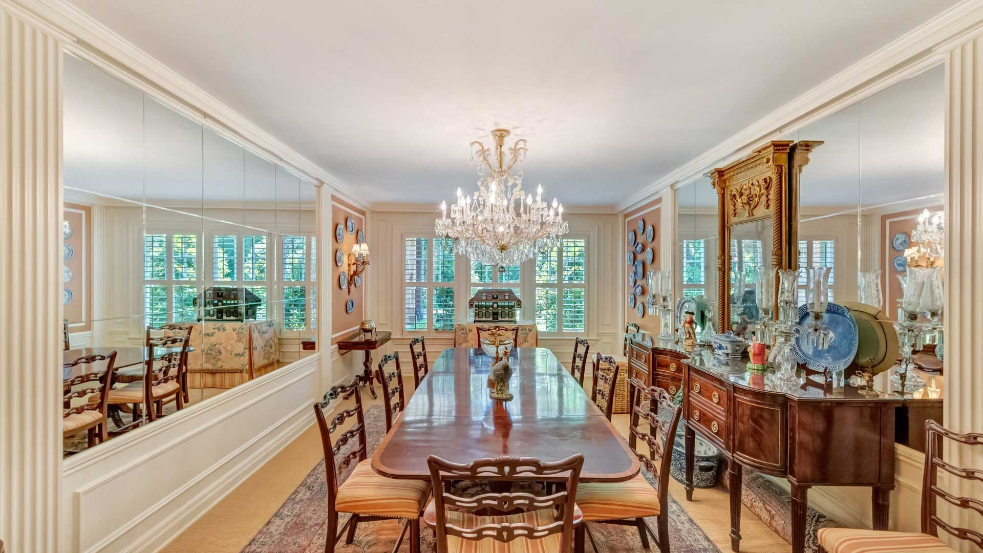 Mirror design dining room with carved wooden dining furniture and side-boards.