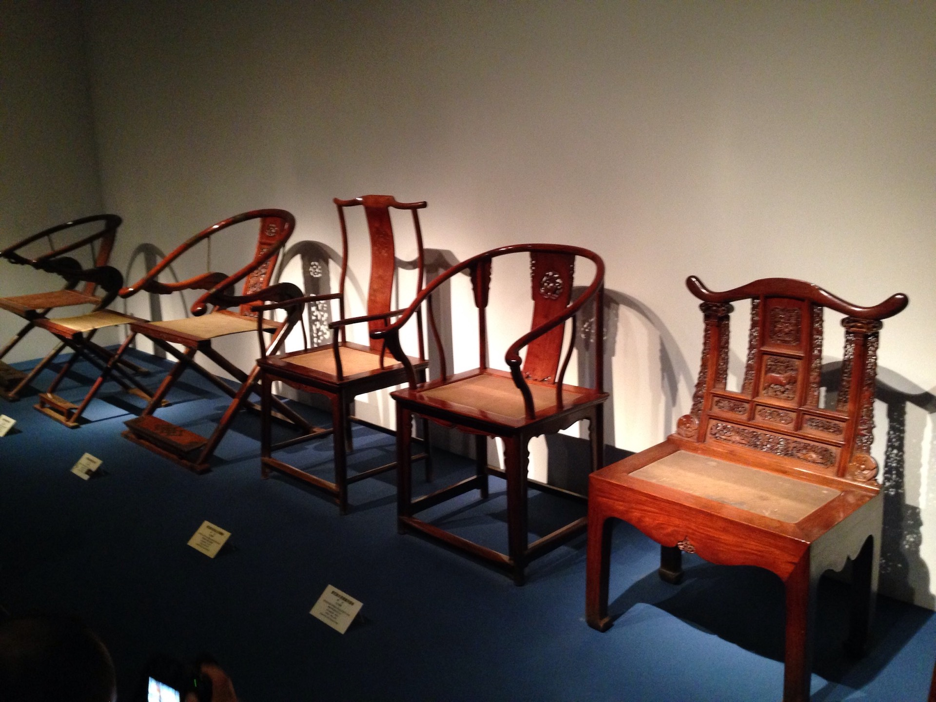 Five traditional Oriental Chinese chairs from Ming Dynasty lined up for display at the Shanghai Museum